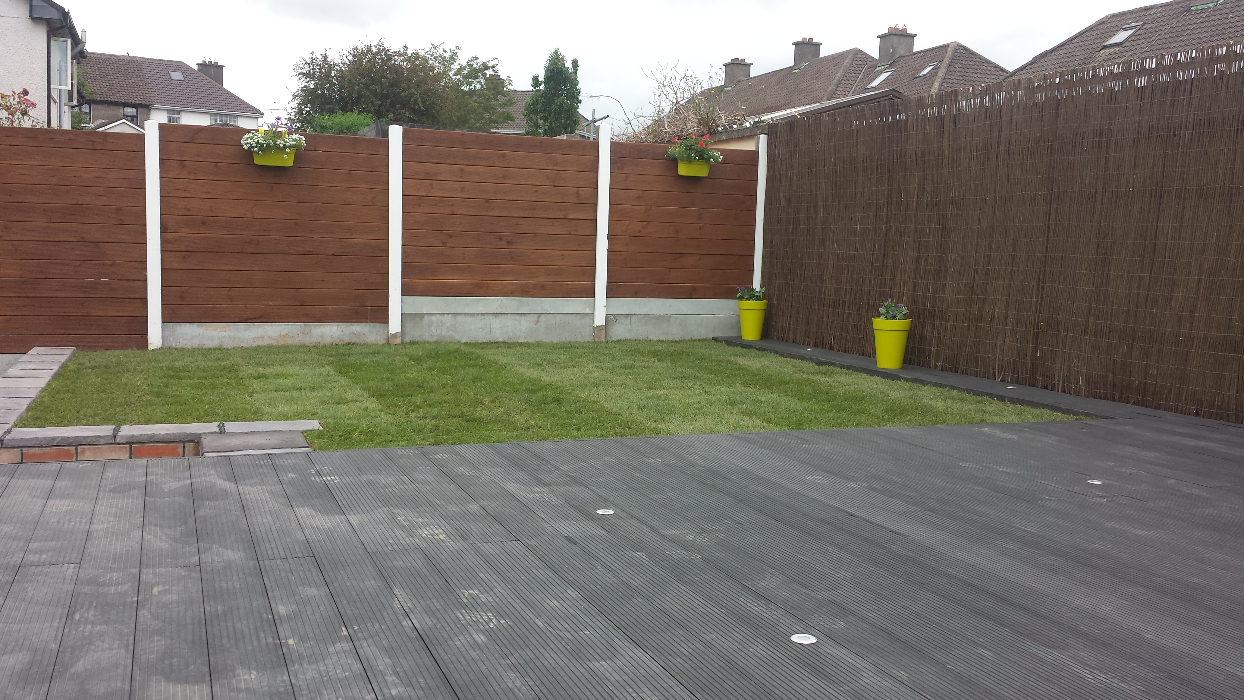 composite decking installed in back garden cork